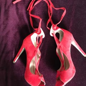 Red suede heels with criss cross straps